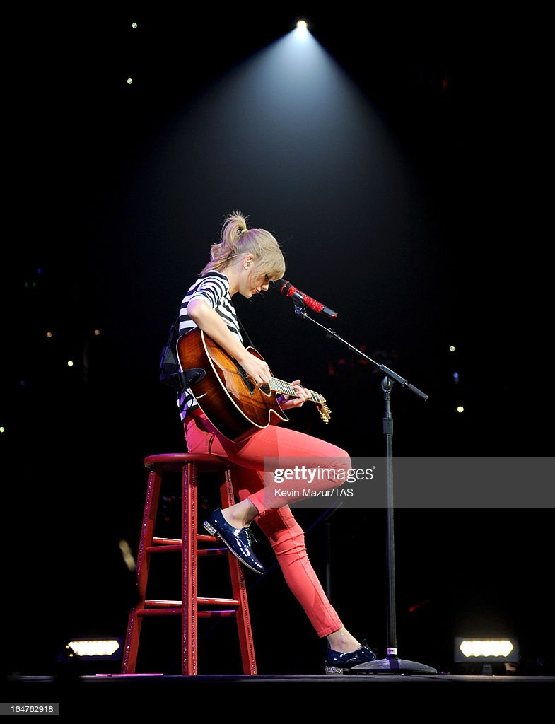 <a gi-track='captionPersonalityLinkClicked' href=/galleries/search?phrase=Taylor+Swift&family=editorial&specificpeople=619504 ng-click='$event.stopPropagation()'>Taylor Swift</a> performs on stage at the Prudential Center on March 27, 2013 in Newark, New Jersey. Seven-time GRAMMY winner <a gi-track='captionPersonalityLinkClicked' href=/galleries/search?phrase=Taylor+Swift&family=editorial&specificpeople=619504 ng-click='$event.stopPropagation()'>Taylor Swift</a> plays 3 sold-out NY area shows at the Prudential Center this week on The RED Tour. Taylor plays electric guitar, banjo, piano and acoustic guitar and changes costumes 10 times over the course of the evening. The North American portion of The RED Tour will play 66 shows (including 13 stadium stops) in 47 cities in 29 states and 3 provinces spanning 6 months in 2013.