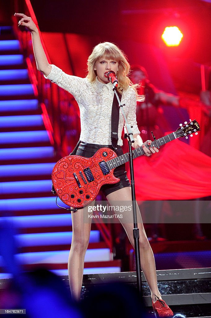 Taylor Swift performs on stage at the Prudential Center on March 27, 2013 in Newark, New Jersey. Seven-time GRAMMY winner Taylor Swift plays 3 sold-out NY area shows at the Prudential Center this week on The RED Tour. Taylor plays electric guitar, banjo, piano and acoustic guitar and changes costumes 10 times over the course of the evening. The North American portion of The RED Tour will play 66 shows (including 13 stadium stops) in 47 cities in 29 states and 3 provinces spanning 6 months in 2013.