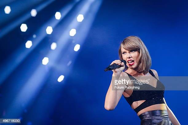 Taylor Swift performs on stage during 'The 1989 World Tour' at the MercedesBenz arena on November 10 2015 in Shanghai China Feature China / Barcroft...