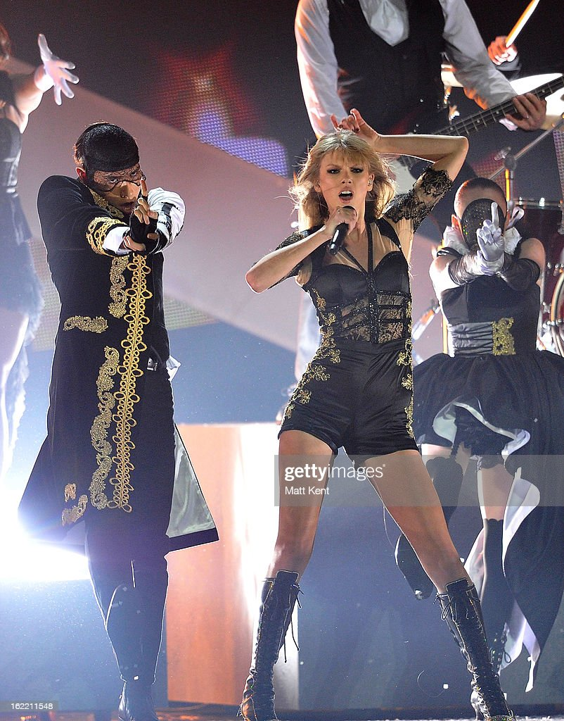 Taylor Swift performs on stage during the Brit Awards 2013 at the 02 Arena on February 20, 2013 in London, England.