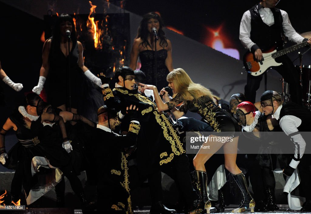 <a gi-track='captionPersonalityLinkClicked' href=/galleries/search?phrase=Taylor+Swift&family=editorial&specificpeople=619504 ng-click='$event.stopPropagation()'>Taylor Swift</a> performs on stage during the Brit Awards 2013 at the 02 Arena on February 20, 2013 in London, England.