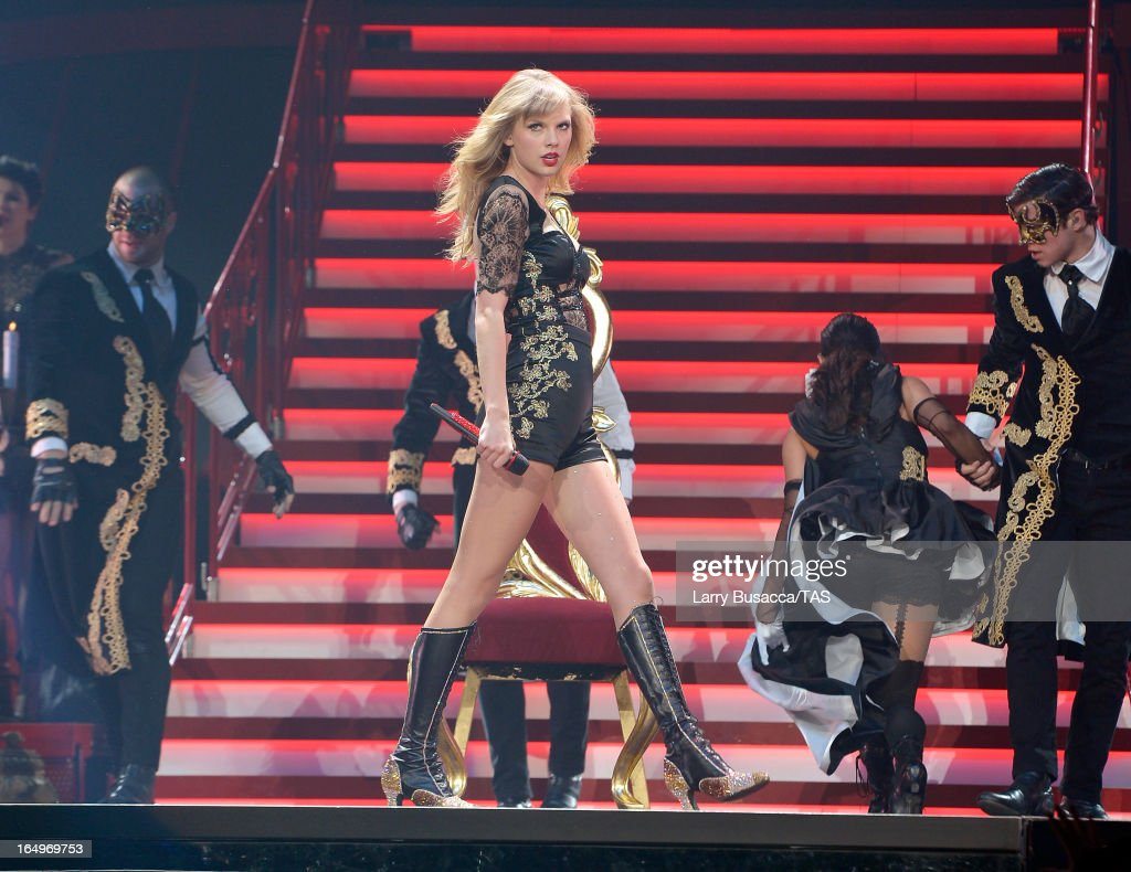 Taylor Swift performs onstage at the Prudential Center on March 29, 2013 in Newark, New Jersey. Seven-time GRAMMY winner Taylor Swift plays 3 sold-out NY area shows at the Prudential Center this week on The RED Tour. Taylor plays electric guitar, banjo, piano and acoustic guitar and changes costumes 10 times over the course of the evening. The North American portion of The RED Tour will play 66 shows (including 13 stadium stops) in 47 cities in 29 states and 3 provinces spanning 6 months in 2013.