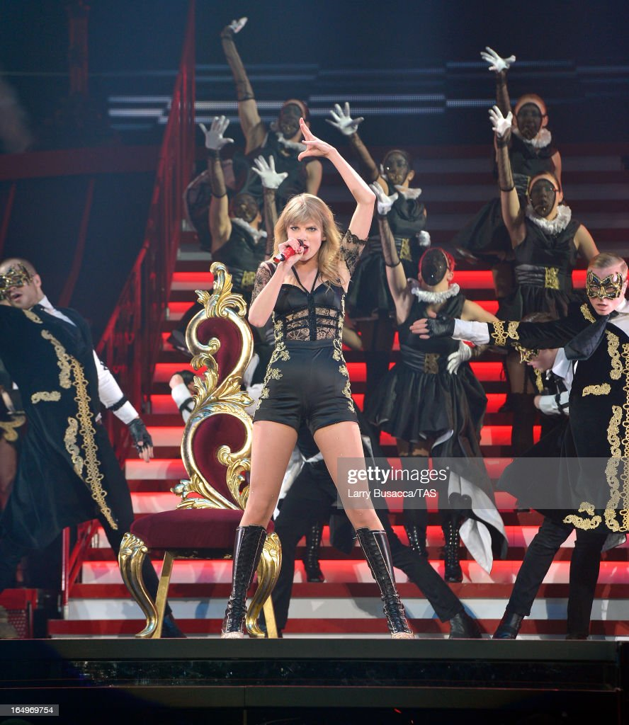 <a gi-track='captionPersonalityLinkClicked' href=/galleries/search?phrase=Taylor+Swift&family=editorial&specificpeople=619504 ng-click='$event.stopPropagation()'>Taylor Swift</a> performs onstage at the Prudential Center on March 29, 2013 in Newark, New Jersey. Seven-time GRAMMY winner <a gi-track='captionPersonalityLinkClicked' href=/galleries/search?phrase=Taylor+Swift&family=editorial&specificpeople=619504 ng-click='$event.stopPropagation()'>Taylor Swift</a> plays 3 sold-out NY area shows at the Prudential Center this week on The RED Tour. Taylor plays electric guitar, banjo, piano and acoustic guitar and changes costumes 10 times over the course of the evening. The North American portion of The RED Tour will play 66 shows (including 13 stadium stops) in 47 cities in 29 states and 3 provinces spanning 6 months in 2013.