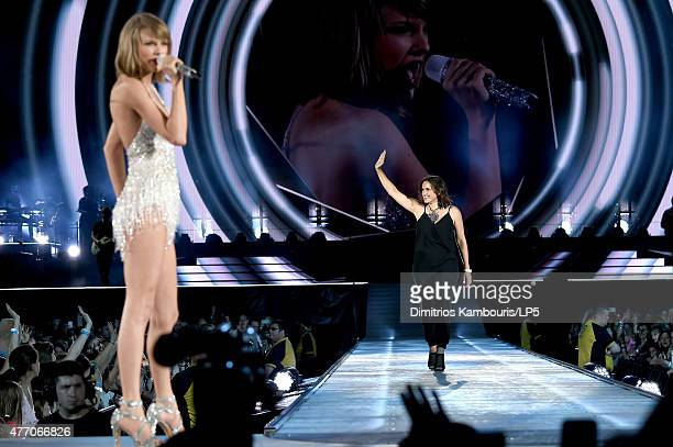 Taylor Swift performs onstage with actress Mariska Hargitay during The 1989 World Tour on June 13 2015 at Lincoln Financial Field in Philadelphia...