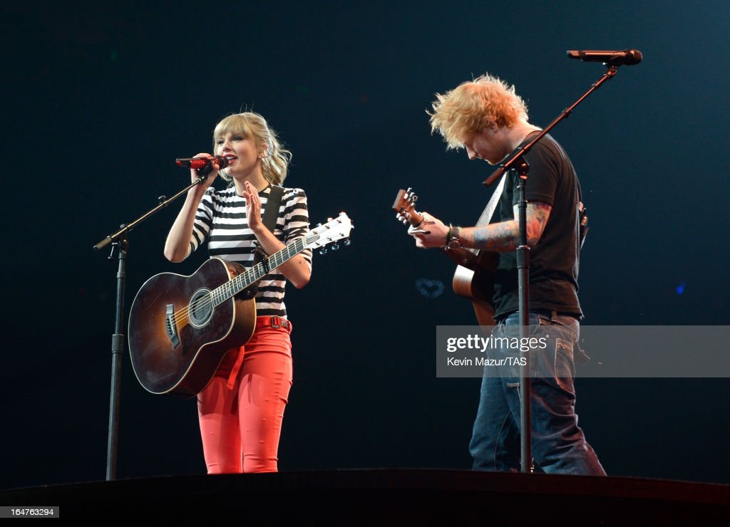 Taylor Swift performs with Ed Sheeran on stage at the Prudential Center on March 27, 2013 in Newark, New Jersey. Seven-time GRAMMY winner Taylor Swift plays 3 sold-out NY area shows at the Prudential Center this week on The RED Tour. Taylor plays electric guitar, banjo, piano and acoustic guitar and changes costumes 10 times over the course of the evening. The North American portion of The RED Tour will play 66 shows (including 13 stadium stops) in 47 cities in 29 states and 3 provinces spanning 6 months in 2013.