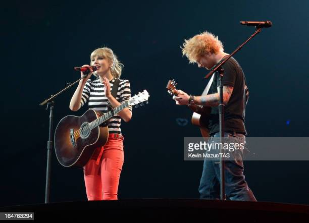 Taylor Swift performs with Ed Sheeran on stage at the Prudential Center on March 27 2013 in Newark New Jersey Seventime GRAMMY winner Taylor Swift...