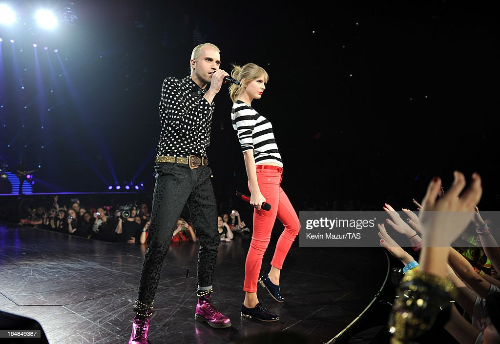 <a gi-track='captionPersonalityLinkClicked' href=/galleries/search?phrase=Taylor+Swift&family=editorial&specificpeople=619504 ng-click='$event.stopPropagation()'>Taylor Swift</a> performs with <a gi-track='captionPersonalityLinkClicked' href=/galleries/search?phrase=Tyler+Glenn&family=editorial&specificpeople=5680345 ng-click='$event.stopPropagation()'>Tyler Glenn</a> of Neon Trees on stage at Prudential Center on March 28, 2013 in Newark, New Jersey. Seven-time GRAMMY winner <a gi-track='captionPersonalityLinkClicked' href=/galleries/search?phrase=Taylor+Swift&family=editorial&specificpeople=619504 ng-click='$event.stopPropagation()'>Taylor Swift</a> plays 3 sold-out NY area shows at the Prudential Center this week on The RED Tour. Taylor plays electric guitar, banjo, piano and acoustic guitar and changes costumes 10 times over the course of the evening. The North American portion of The RED Tour will play 66 shows (including 13 stadium stops) in 47 cities in 29 states and 3 provinces spanning 6 months in 2013.