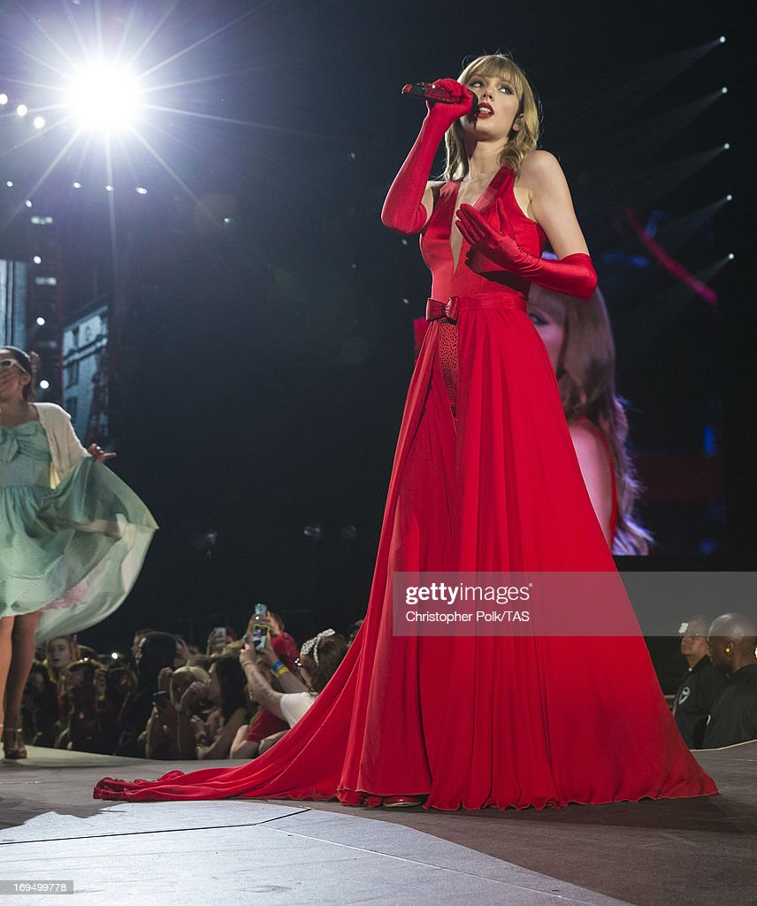 <a gi-track='captionPersonalityLinkClicked' href=/galleries/search?phrase=Taylor+Swift&family=editorial&specificpeople=619504 ng-click='$event.stopPropagation()'>Taylor Swift</a> plays for a sold-out crowd of more than 53,000 fans on the second of 13 North American stadium dates on The RED Tour at Cowboys Stadium on May 25, 2013 in Arlington, Texas.