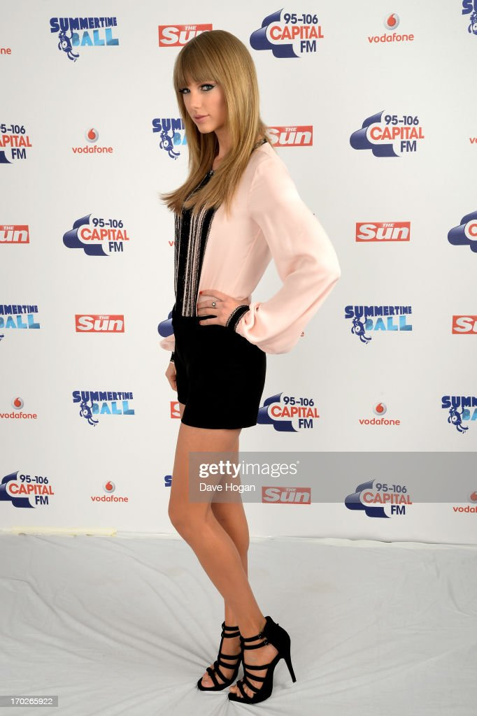Taylor Swift poses in a backstage studio during the Capital Summertime Ball at Wembley Stadium on June 9, 2013 in London, England.