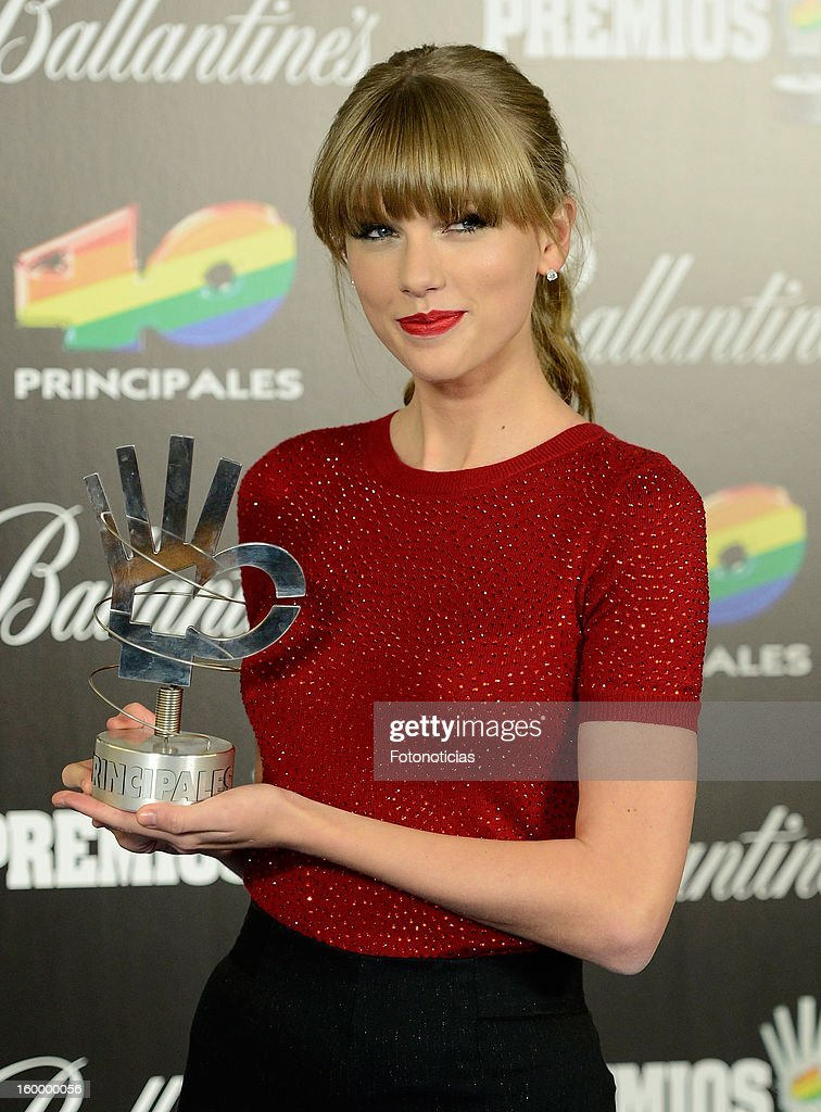 <a gi-track='captionPersonalityLinkClicked' href=/galleries/search?phrase=Taylor+Swift&family=editorial&specificpeople=619504 ng-click='$event.stopPropagation()'>Taylor Swift</a> poses in the press room during '40 Principales Awards' 2012 at the Palacio de Deportes on January 24, 2013 in Madrid, Spain.