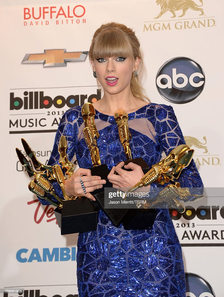<a gi-track='captionPersonalityLinkClicked' href=/galleries/search?phrase=Taylor+Swift&family=editorial&specificpeople=619504 ng-click='$event.stopPropagation()'>Taylor Swift</a> poses in the press room with presented Billboard awards during the 2013 Billboard Music Awards at the MGM Grand Garden Arena on May 19, 2013 in Las Vegas, Nevada.