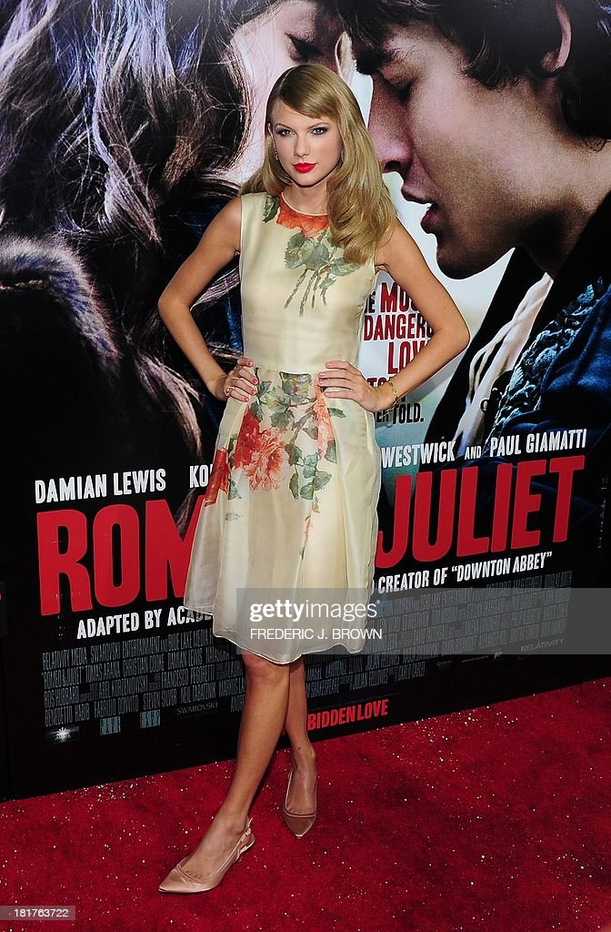 Taylor Swift poses on arrival on the red carpet at the World Premiere of the film 'Romeo & Juliet' in Hollywood, California, on September 24, 2013. AFP PHOTO/Frederic J. BROWN
