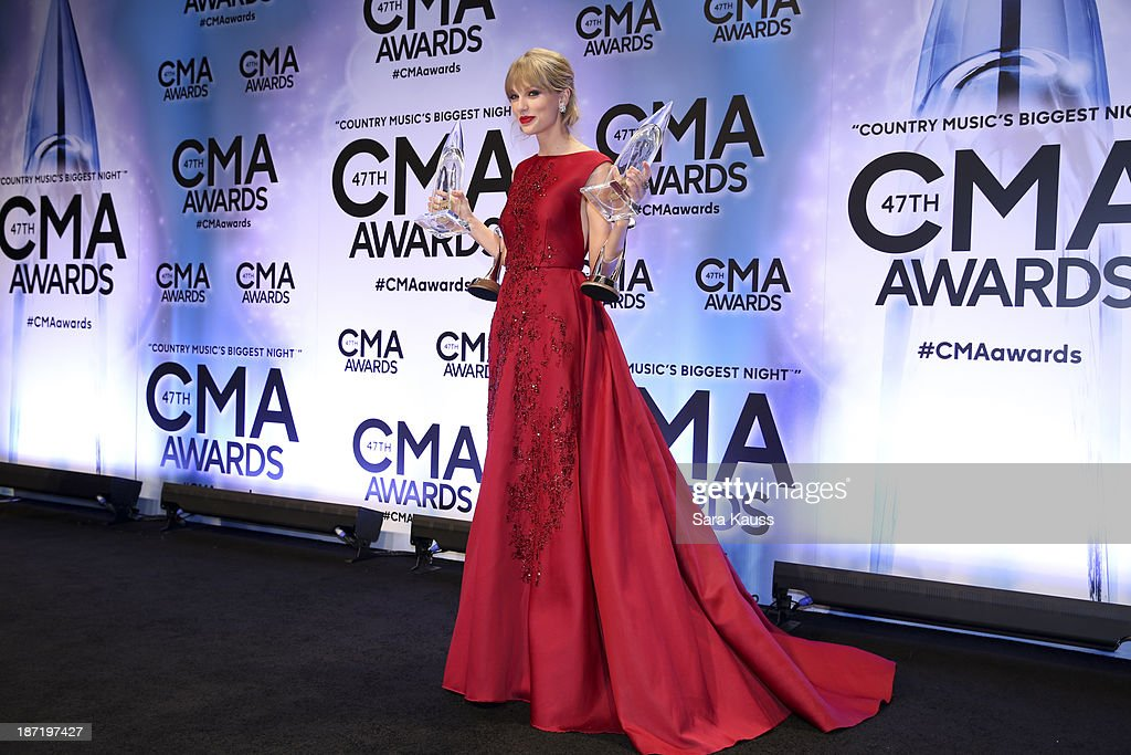 <a gi-track='captionPersonalityLinkClicked' href=/galleries/search?phrase=Taylor+Swift&family=editorial&specificpeople=619504 ng-click='$event.stopPropagation()'>Taylor Swift</a> receives an award at the 47th annual CMA Awards at the Bridgestone Arena on November 6, 2013 in Nashville, Tennessee.