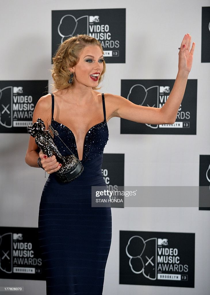 <a gi-track='captionPersonalityLinkClicked' href=/galleries/search?phrase=Taylor+Swift&family=editorial&specificpeople=619504 ng-click='$event.stopPropagation()'>Taylor Swift</a>, winner of Best Female Video, walks from stage at the MTV Video Music Awards August 25, 2013 at the Barclays Center in New York. AFP PHOTO/Stan HONDA