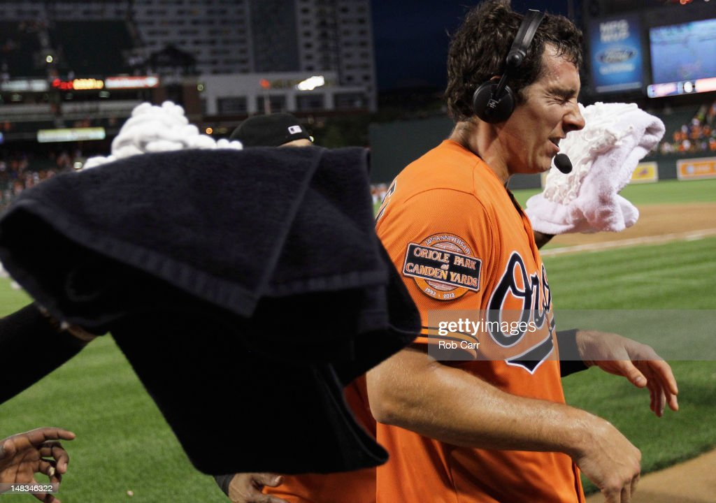 <a gi-track='captionPersonalityLinkClicked' href=/galleries/search?phrase=Taylor+Teagarden&family=editorial&specificpeople=835625 ng-click='$event.stopPropagation()'>Taylor Teagarden</a> #31 of the Baltimore Orioles gets hit with shaving cream from teammates after hitting the game winning home run to defeat the Detroit Tigers 8-6 in thirteen innings at Oriole Park at Camden Yards on July 14, 2012 in Baltimore, Maryland.