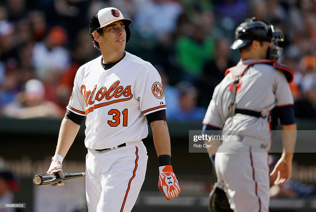 <a gi-track='captionPersonalityLinkClicked' href=/galleries/search?phrase=Taylor+Teagarden&family=editorial&specificpeople=835625 ng-click='$event.stopPropagation()'>Taylor Teagarden</a> #31 of the Baltimore Orioles walks back to the dugout after striking out looking in the seventh inning of the Orioles 4-3 loss to the Minnesota Twins at Oriole Park at Camden Yards on April 7, 2013 in Baltimore, Maryland.