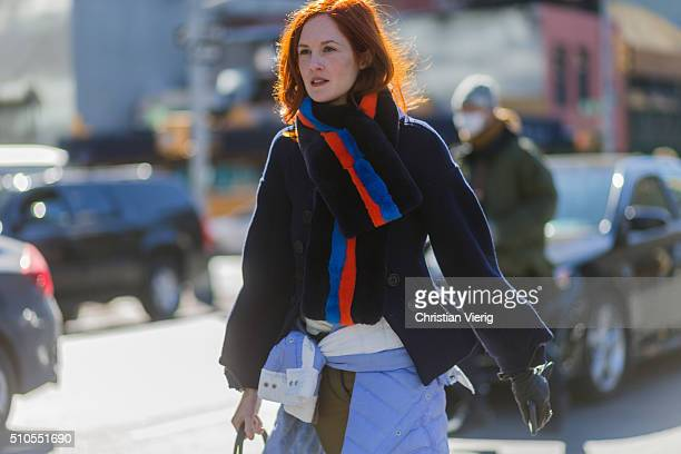 Taylor Tomasi Hill is wearing a fake fur scarf a dark blue wool jacket and a jacket knotted seen outside Public School during New York Fashion Week...
