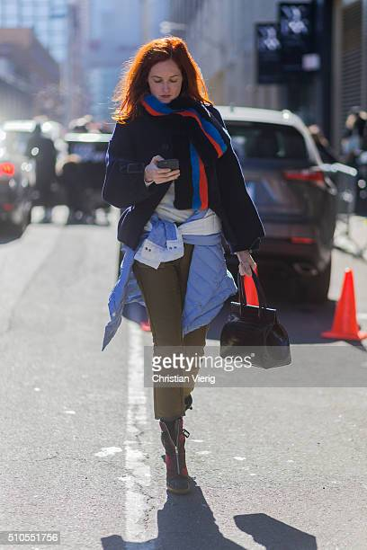 Taylor Tomasi Hill is wearing a fake fur scarf a dark blue wool jacket and a jacket knotted seen outside Derek Lam during New York Fashion Week...