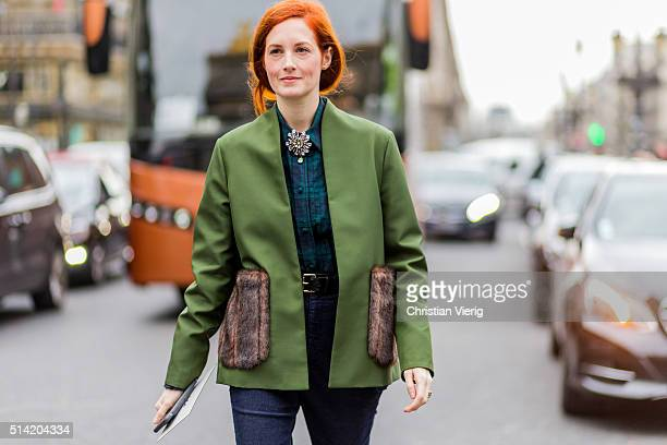 Taylor Tomasi Hill wearing a green jacket navy denim jeans and a green plaid shirt outside Stella McCartney during the Paris Fashion Week Womenswear...