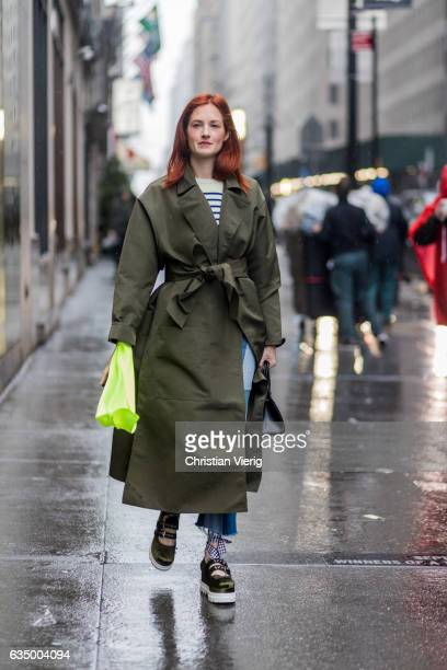 Taylor Tomasi Hill wearing an olive belted coat Miu Miu creepers outside Victoria Beckham on February 12 2017 in New York City