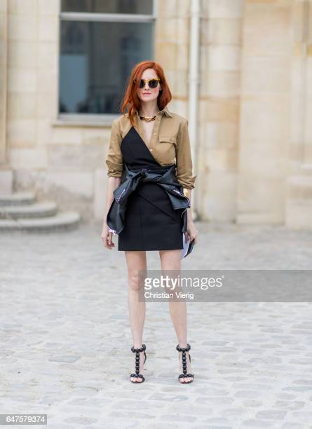 Taylor Tomasi Hill wearing brown button shirt dress outside Dior on March 3 2017 in Paris France
