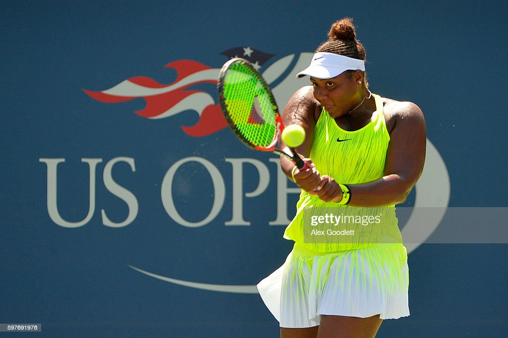Taylor Townsend of the United States returns a shot to Caroline Wozniacki of Denmark during her first round Women's Singles match on Day One of the...