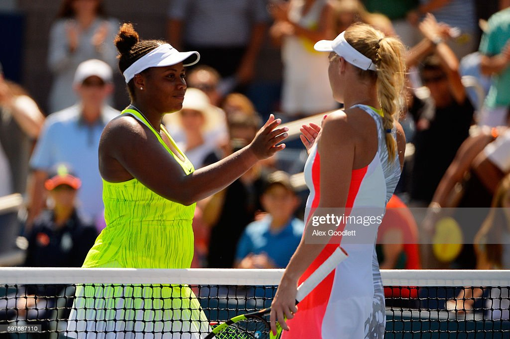 Taylor Townsend of the United States shakes hands with Caroline Wozniacki of Denmark after being defeated in her first round Women's Singles match on...