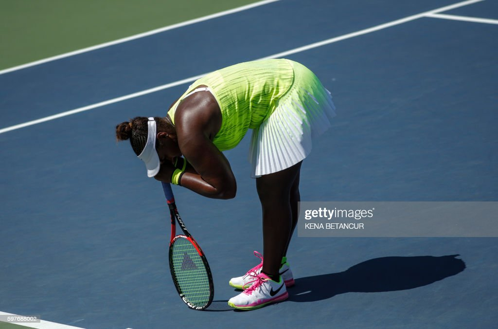 Taylor Townsend of the US reacts while she plays against Caroline Wozniacki of Denmark during their 2016 US Open 2016 Women's Singles Round 1 match...