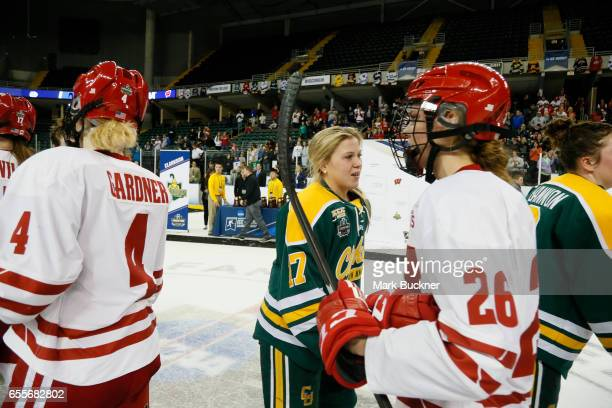 Taylor Turnquist of the Clarkson Golden Knights participates in the traditional post game handshake during the Division I Women's Ice Hockey...