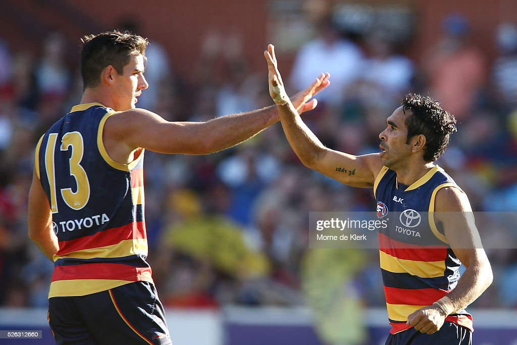Taylor Walker and <a gi-track='captionPersonalityLinkClicked' href=/galleries/search?phrase=Eddie+Betts&family=editorial&specificpeople=546295 ng-click='$event.stopPropagation()'>Eddie Betts</a> of the Crows celebrate a goal by Betts during the round six AFL match between the Adelaide Crows and the Fremantle Dockers at Adelaide Oval on April 30, 2016 in Adelaide, Australia.