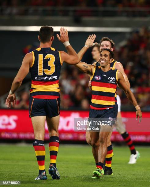 Taylor Walker and Eddie Betts of the Crows celebrate a goal during the round four AFL match between the Adelaide Crows and the Essendon Bombers at...