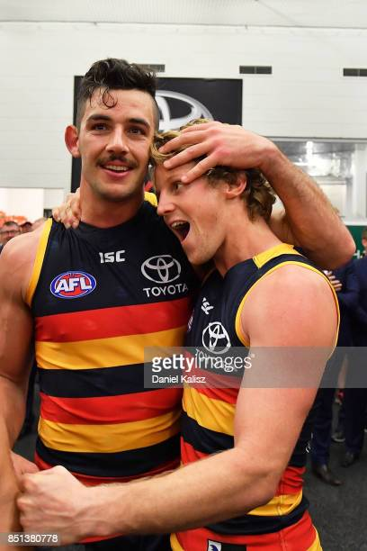 Taylor Walker and Rory Sloane of the Crows celebrate after the First AFL Preliminary Final match between the Adelaide Crows and the Geelong Cats at...