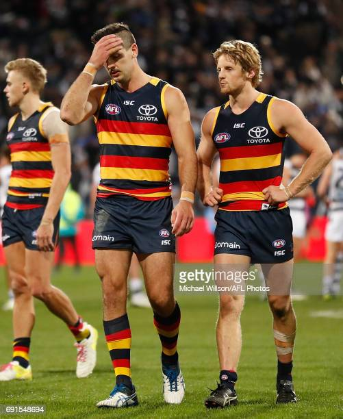 Taylor Walker and Rory Sloane of the Crows look dejected after a loss during the 2017 AFL round 11 match between the Geelong Cats and the Adelaide...