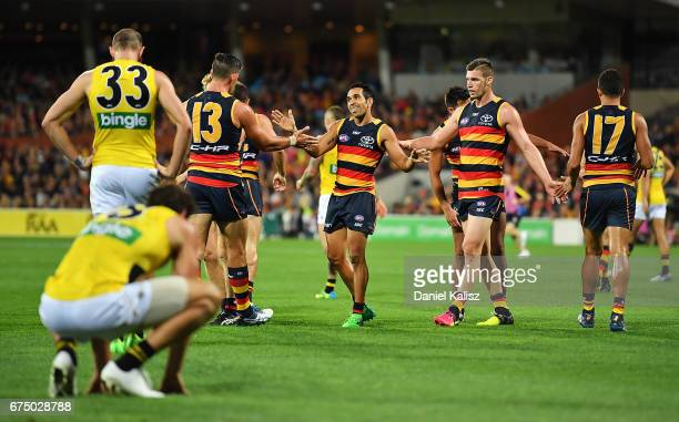 Taylor Walker Eddie Betts and Josh Jenkins of the Crows celebrate a goal during the round six AFL match between the Adelaide Crows and the Richmond...