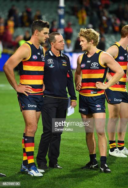 Taylor Walker of the Crows Adelaide Crows Senior Coach Don Pyke and Rory Sloane of the Crows look on after the round eight AFL match between the...