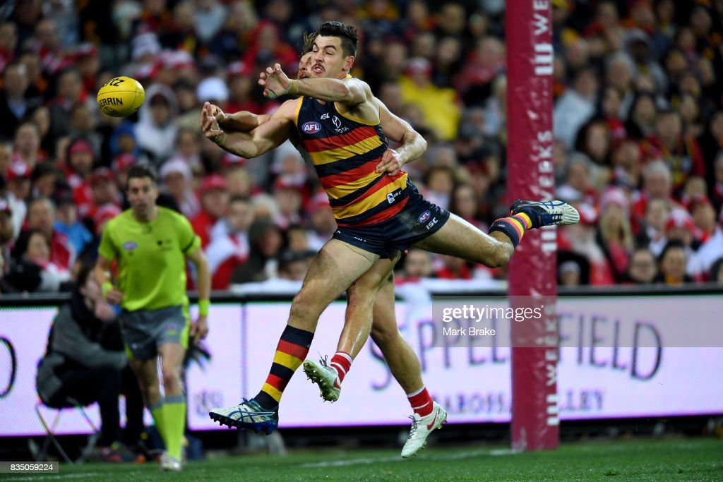 Taylor Walker of the Crows and Dane Rampe of the Swans competes during the round 22 AFL match between the Adelaide Crows and the Sydney Swans at Adelaide Oval on August 18, 2017 in Adelaide, Australia.