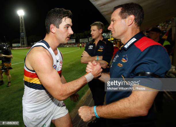 Taylor Walker of the Crows and Don Pyke Senior Coach of the Crows celebrate during the 2017 AFL round 17 match between the Melbourne Demons and the...
