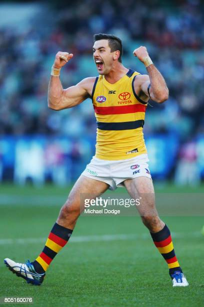 Taylor Walker of the Crows celebrates a goal during the round 15 AFL match between the Carlton Blues and the Adelaide Crows at Melbourne Cricket...