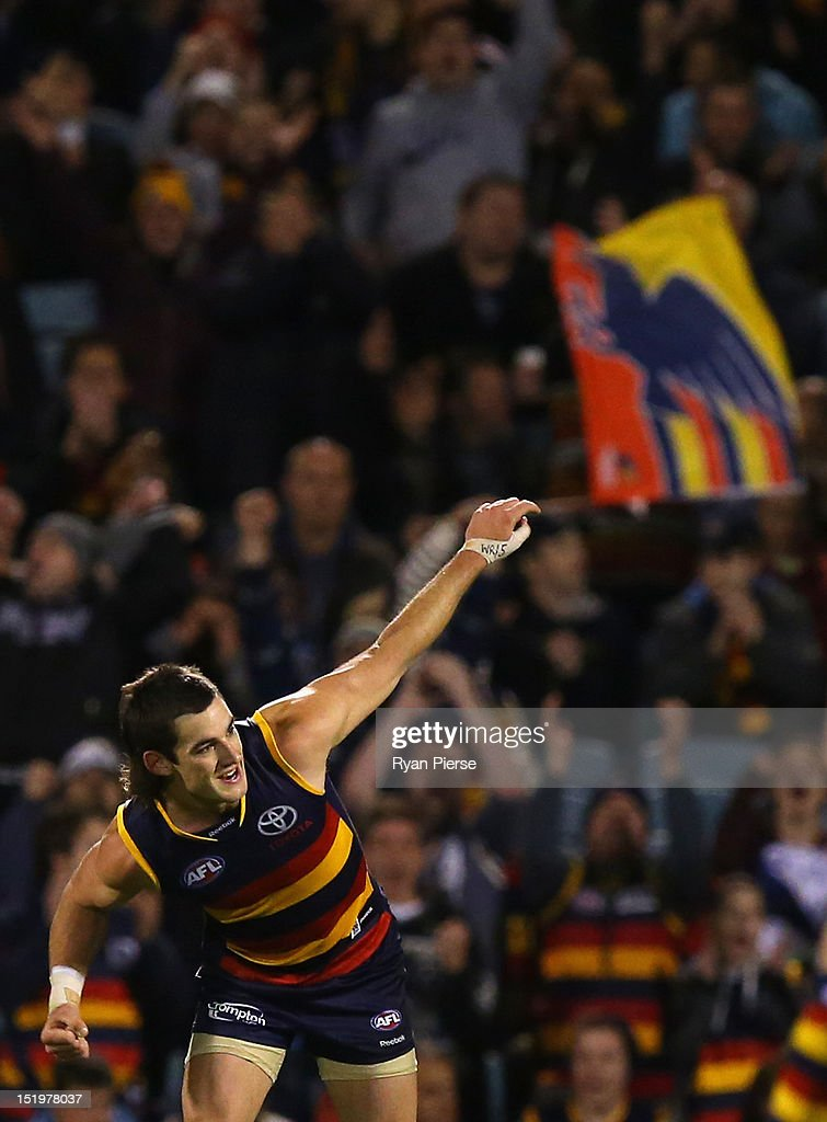 Taylor Walker of the Crows celebrates after kicking a goal during the AFL Second Semi Final match between the Adelaide Crows and the Fremantle Dockers at AAMI Stadium on September 14, 2012 in Adelaide, Australia.