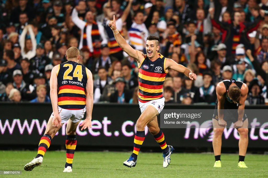 Taylor Walker of the Crows celebrates after kicking a goal during the round three AFL match between the Port Adelaide Power and the Adelaide Crows at Adelaide Oval on April 8, 2017 in Adelaide, Australia.