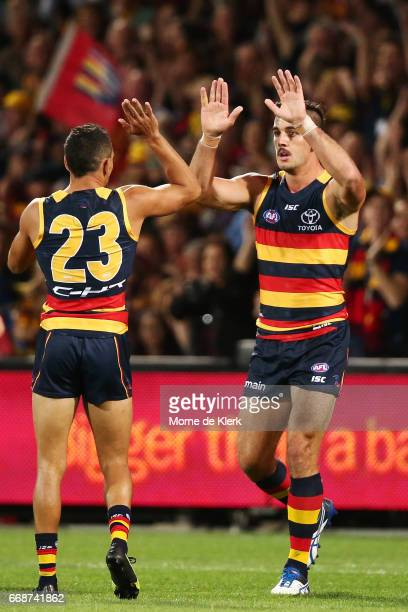 Taylor Walker of the Crows celebrates with Charlie Cameron of the Crows after Walker kicked a goal during the round four AFL match between the...