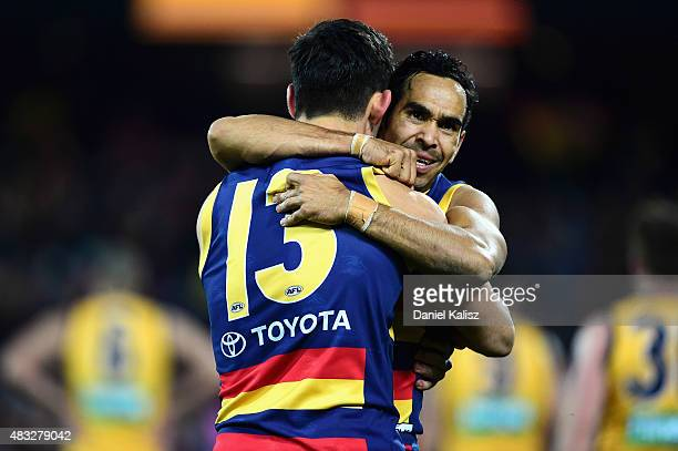 Taylor Walker of the Crows celebrates with Eddie Betts of the Crows after scoring a goal during the round 19 AFL match between the Adelaide Crows and...