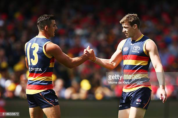 Taylor Walker of the Crows congratulates teammate Josh Jenkins after he kicked a goal during the round two AFL match between the Adelaide Crows and...
