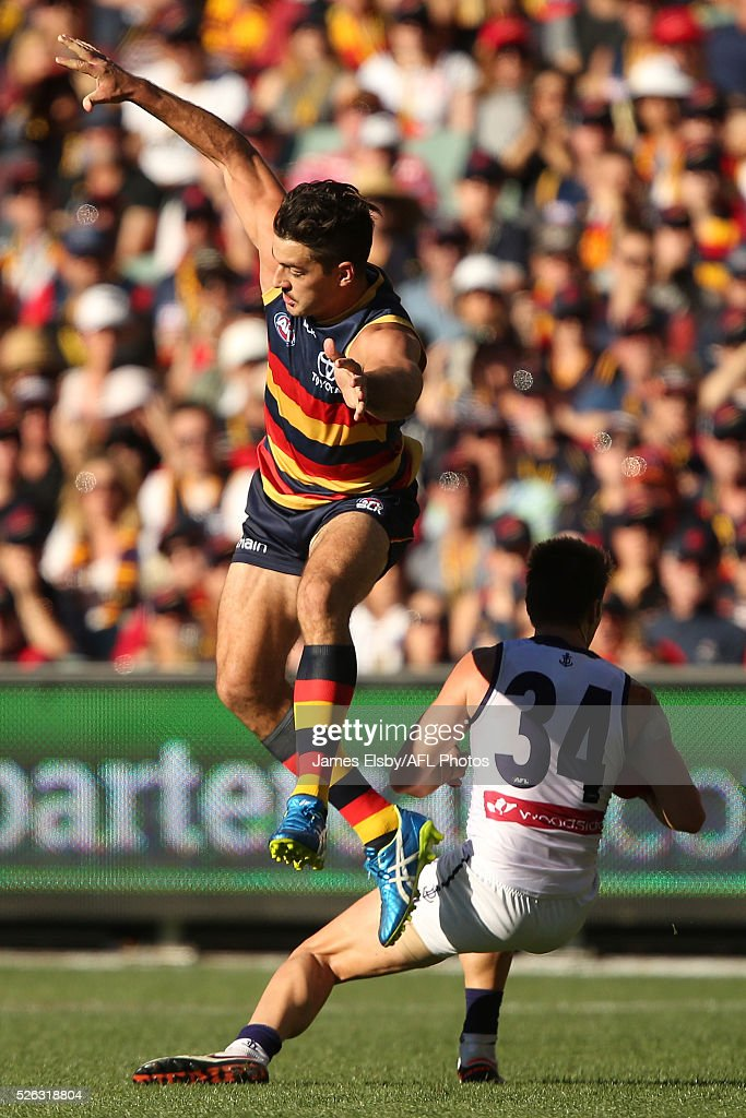 Taylor Walker of the Crows flies over Lee Spurr of the Dockers during the 2016 AFL Round 06 match between the Adelaide Crows and the Fremantle Dockers at Adelaide Oval, Adelaide on April 30, 2016.