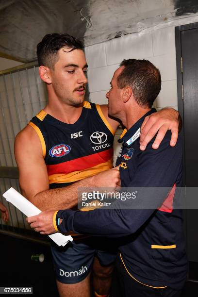 Taylor Walker of the Crows is congratulated by Adelaide Crows Senior Coach Don Pyke after the round six AFL match between the Adelaide Crows and the...