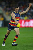Taylor Walker of the Crows kicks the ball during the round 18 AFL match between the Geelong Cats and the Adelaide Crows at Simonds Stadium on July 23...