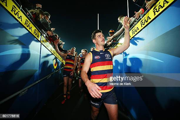 Taylor Walker of the Crows leads his team from the field after the AFL 1st Elimination Final match between the Adelaide Crows and the North Melbourne...