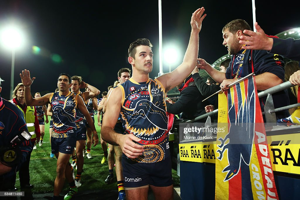 Taylor Walker of the Crows leads his team off the ground after winning the round 10 AFL match between the Adelaide Crows and the Greater Western Sydney Giants at Adelaide Oval on May 28, 2016 in Adelaide, Australia.