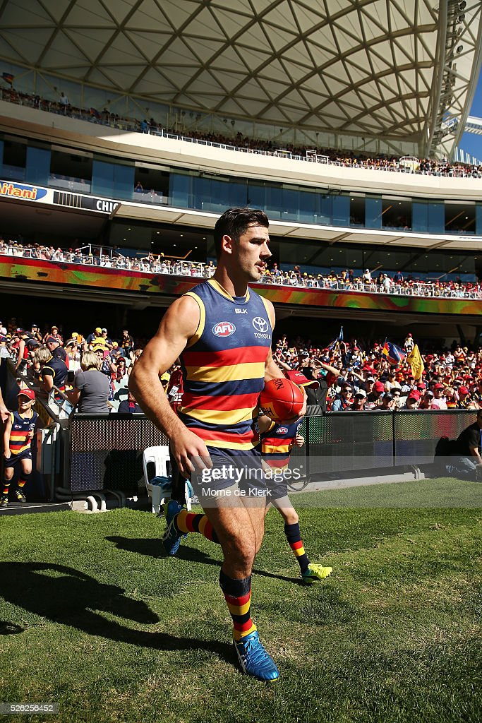 Taylor Walker of the Crows leads his team onto the ground during the round six AFL match between the Adelaide Crows and the Fremantle Dockers at Adelaide Oval on April 30, 2016 in Adelaide, Australia.