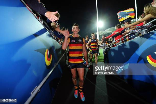 Taylor Walker of the Crows leads the team from the field after the round nine AFL match between the Adelaide Crows and the Collingwood Magpies at...